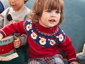 Festivewear for Baby. Christmas jumpers to keep little ones snuggly.